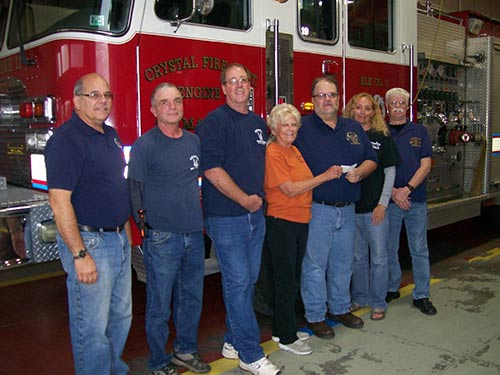 Check presented to the Crystal Fire Dept from mass collection and Bavarian Fall Fest